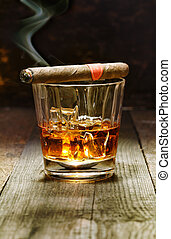 Cuban cigar and glass of brandy - Burning Cuban cigar...