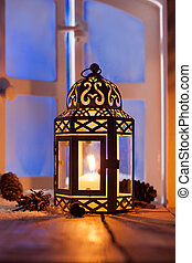 Christmas lantern with glowing candle - Ornamental Christmas...