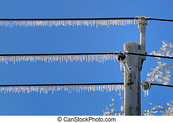 Icicles on Line - Icicles hanging from power lines after ice...