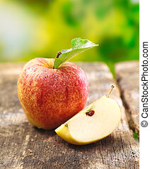Quartered apple showing juicy flesh - Quartered apple...