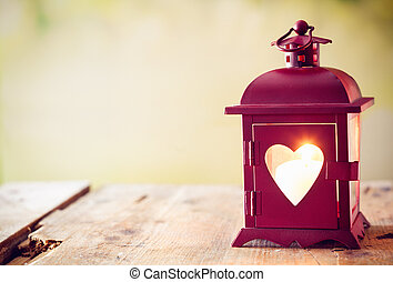 Glowing lantern with a heart - Decorative red metal lantern...