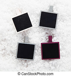 Instant photo frames on snow - Four empty retro instant...
