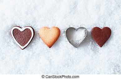 Romantic Christmas heart cookies with gingerbread and a...