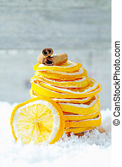 Dried orange slices and cinnamon - A stack of dried orange...