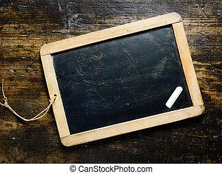 Blank blackboard with chalk