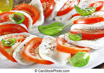 Cheese and tomato salad with herbs - Artistically arranged...