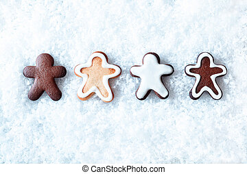 Row of gingerbread men in snow - Row of decorative freshly...