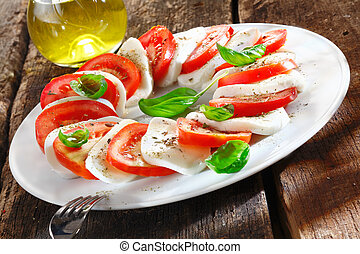 Colourful slices of cheese and tomato arranged alternately...