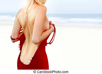 back of woman on shore l