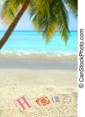 tropical hola - hello in spanish, hola on a mound of sand on...