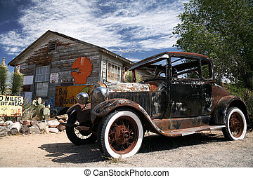 old american ford beside vintage house