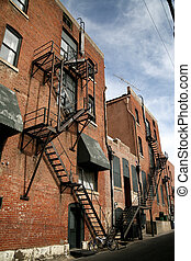 Beautiful old metal fire escape with shadows on brick...