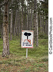 Fire danger signal - Forest fire danger sign, trees and...