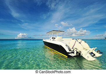 Beautiful beach with motor boat at Boracay island,...