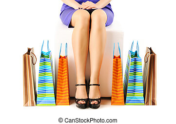 Woman with shopping bags - Womans legs and shopping bags