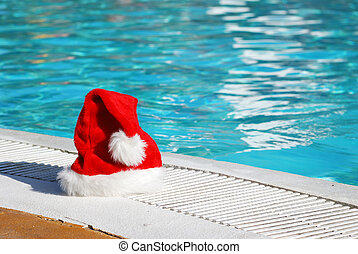 Tropical christmas - Santa hat near the swimming pool