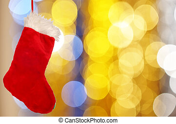 Christmas stocking against defocused background with shallow...