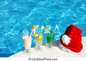 Tropical christmas - Santa hat and cocktails near the...