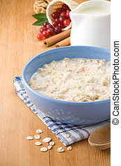 bowl of oatmeal with berry and milk - Bowl of oatmeal with...