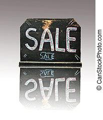 Blackboard with the word sale written on it