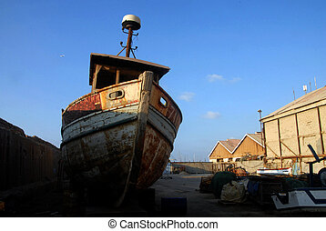 Ancient Yaffo Port Israel - An old fishing boat in ancient...