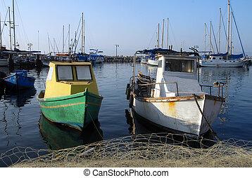Akko Port Israel - An old fishing boat mooring at ancient...