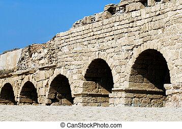 Old Caesarea aqueduct bridge in Caesarea, Israel.