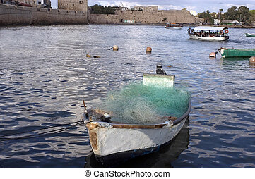 Akko Port Israel - An old fishing boat mooring at ancient...