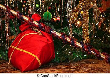 santa bag with gifts at christmas tree