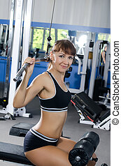 Woman on training apparatus in club