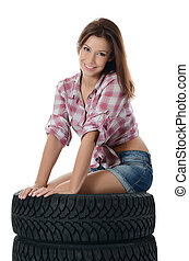 The girl with automobile tyres