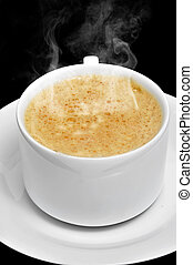 caffe latte - closeup of a cup with caffe latte on a black...
