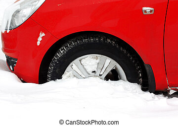 snowfall covered wheel car in city