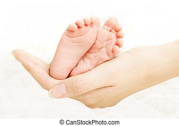 Baby legs in mother hands