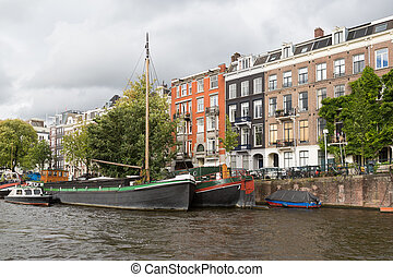 City view of historic Amsterdam, seen from river Amstel