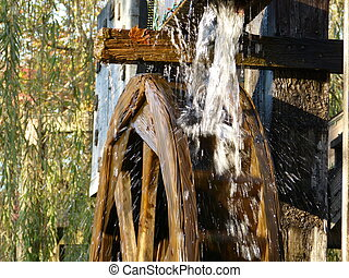 Water Mill - A water mill churning with water