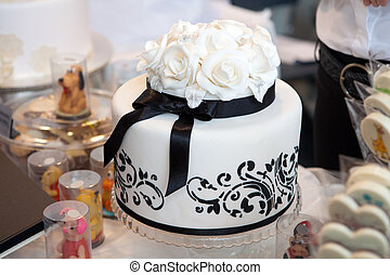 Elegant wedding cake with white roses