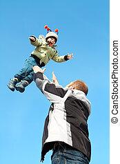 Flying child over sky