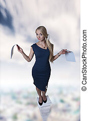 far to much paper work - woman standing on a large pile of...