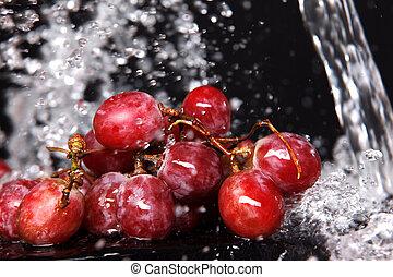 fresh red grape under water splash
