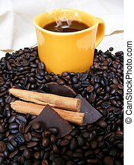 coffe canela - coffee cup with beans,chocolate and cinnamon