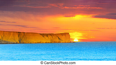 Dramatic seascape Summer sunset with huge cliff