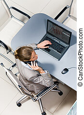 Phoning - View from above of executive secretary speaking on...
