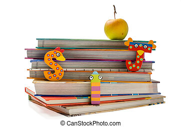 Education concept - Stack of books with funny letters and a...