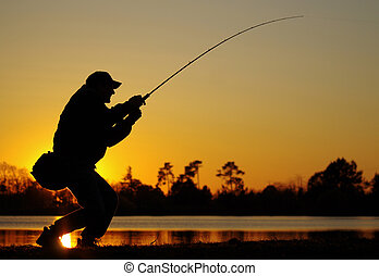 Fish fight - A fisherman fight against a fish at sunset