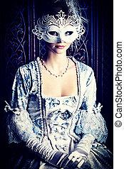carnival - Art portrait of a beautiful female model in a...
