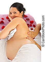 Pregnant woman massage - Therapist man massaging back to...