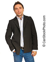 Handsome business man standing with hand in pants pocket...