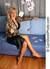 woman with flying cards at sofa
