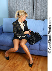 woman with bag at sofa in room
